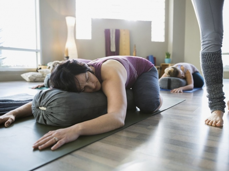 best restorative yoga poses with bolster photo