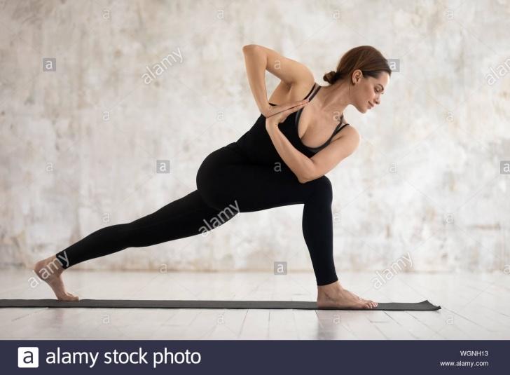 easy yoga standing twist poses photo